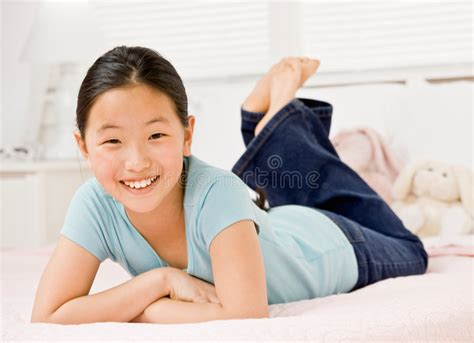 how to be more confident in bed confident girl laying on bed in bedroom stock images