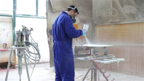 worker painting in a factory industrial painting with