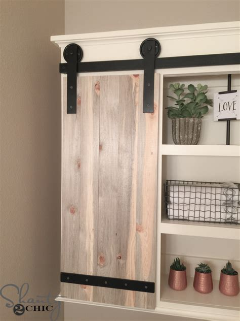 a sliding barn door diy sliding barn door bathroom cabinet shanty 2 chic