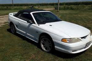 white 1996 ford mustang gt convertible