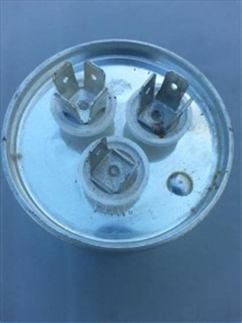 changing capacitor of fan how to replace a condenser fan motor on a hvac refrigeration unit heat air conditioner