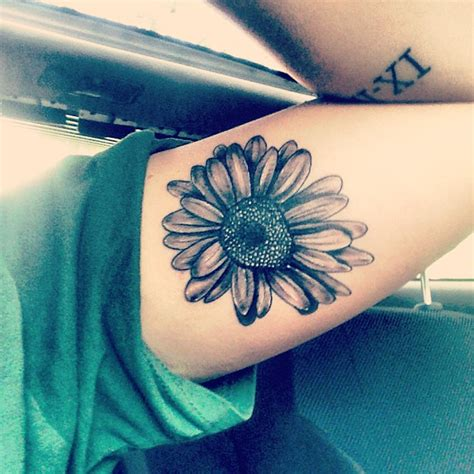black and grey daisy tattoos grey ink daisy flower tattoo on left tattooshunt com