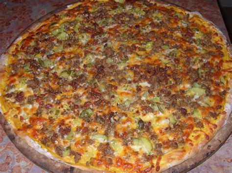 table bacon pizza on the table bacon cheeseburger pizza
