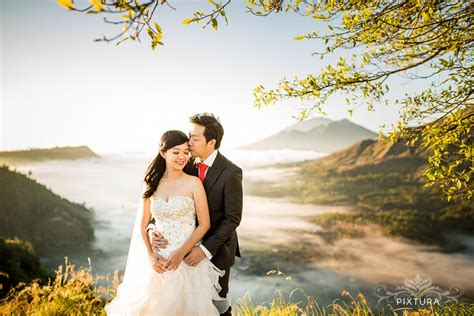 Pre Wedding Photos by Bali Prewedding Erik Huiny On The Clouds