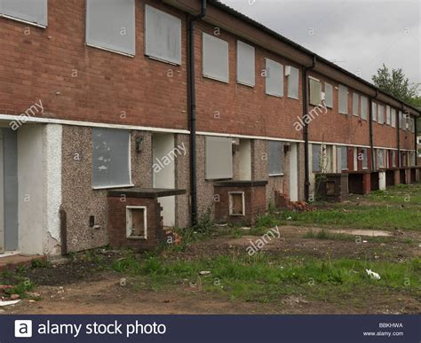 how to buy abandoned houses stack of abandoned houses all boarded up in a desolate housing estate stock photo