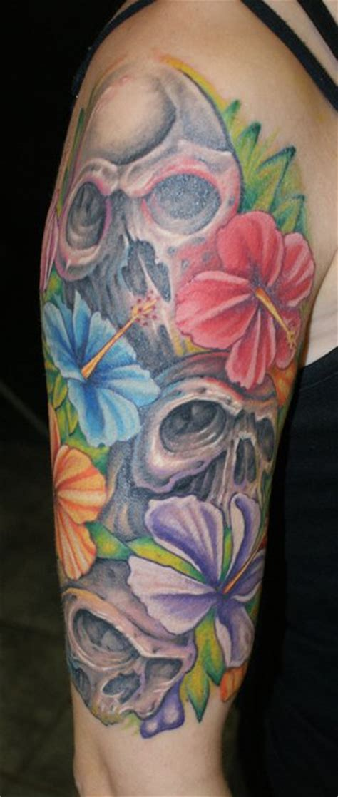 skull flower sleeve rites of passage tattoo