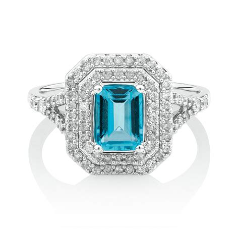 ring with blue topaz 1 2 carat tw of diamonds in 10kt