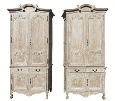 a beautiful pair of antique painted armoire