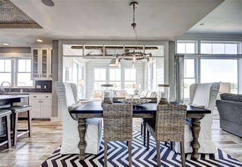coastal dining room furniture ranch style home with transitional coastal interiors