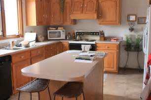 Kitchen With Light Oak Cabinets by The Stone Studio Granite Countertops Batesville Indiana