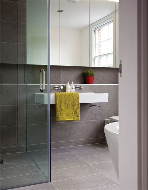floating bathroom floor curbless shower with large format tiles on floor and wall