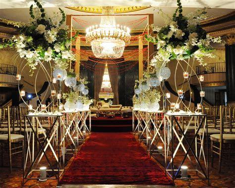 Elegant Indian wedding decoration with burgundy runner and