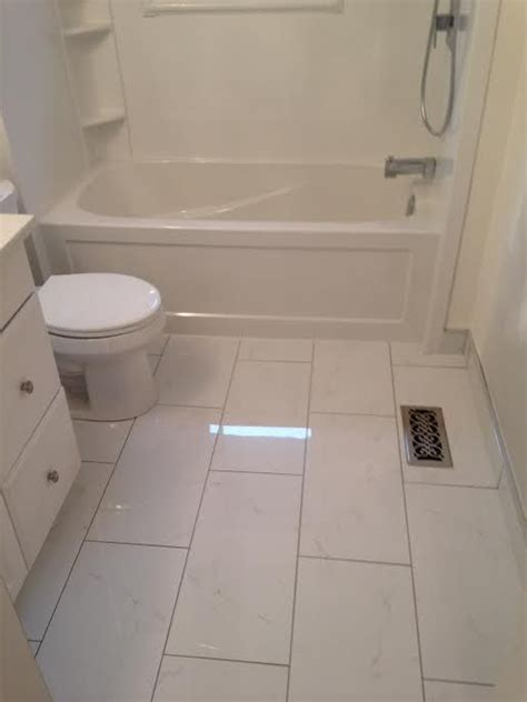 ceramic tile   floor white cabinet tub toilet  small bathroom bathroom