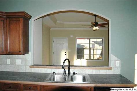 Arch Between Kitchen And Living Room by Don T Be Separated In The Kitchen Large Arch Opening