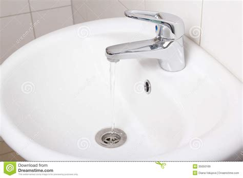 white faucet bathroom bathroom interior with white sink and faucet stock image