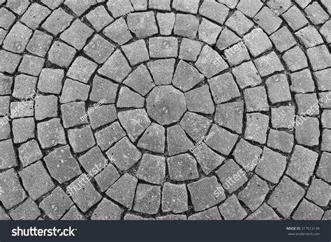 tile pattern round round stone pavement pattern top view stock photo