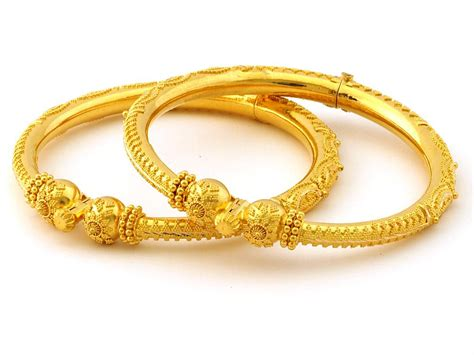 Indian Jewellery and Clothing: Light weight gold and enameled bangles..