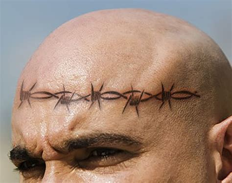 barbed wire tattoo meaning the and frightening meanings of prison tattoos