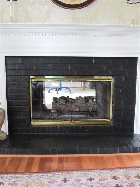 Black Painted Brick Fireplace by Painting Brick Fireplace Black Fireplace Design Ideas