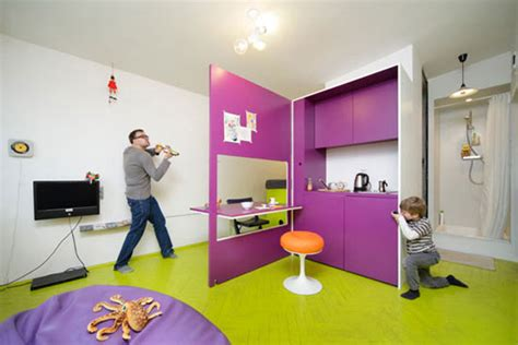 green and purple living room playful interior design of a very small apartment