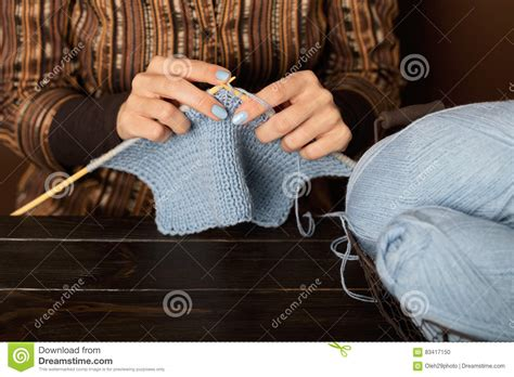 how to yrn in knitting knitting from light blue yarn stock photo
