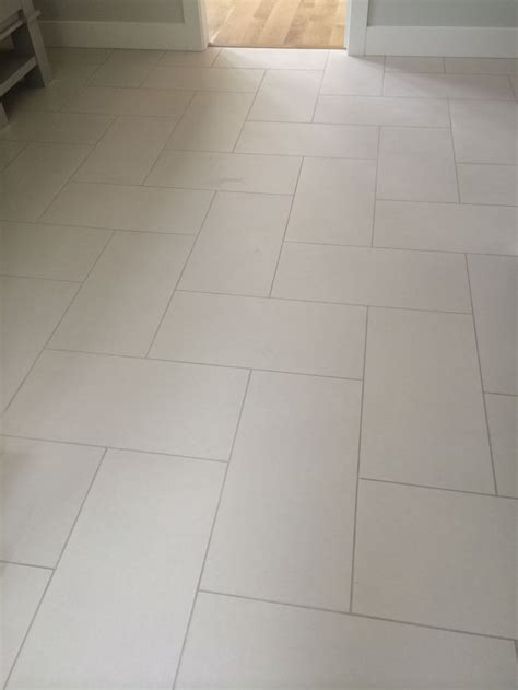 12x24 tile in herringbone pattern with sahara beige grout