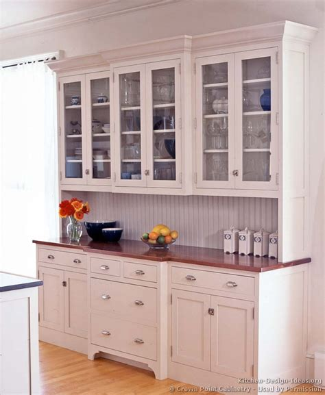 what to display in glass kitchen cabinets pictures of kitchens traditional white kitchen