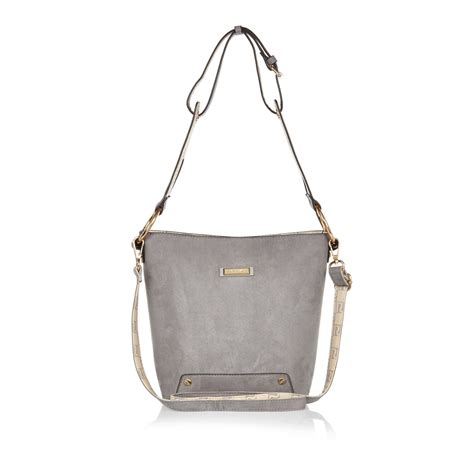 river island gray grey monogram lined bucket handbag lyst