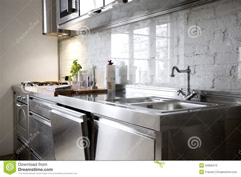 Stainless Steel Faucet Kitchen modern kitchen with stainless steel appliances stock image