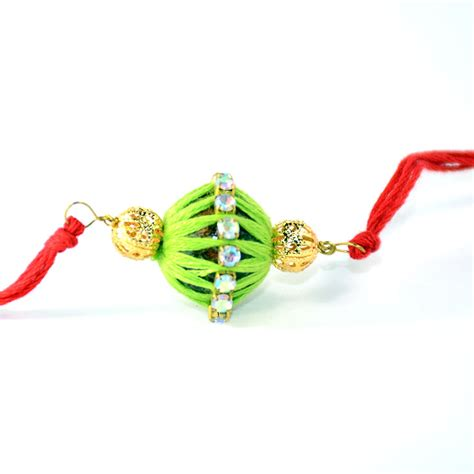 Handmade Rakhi - handmade rakhi dolki in green and color