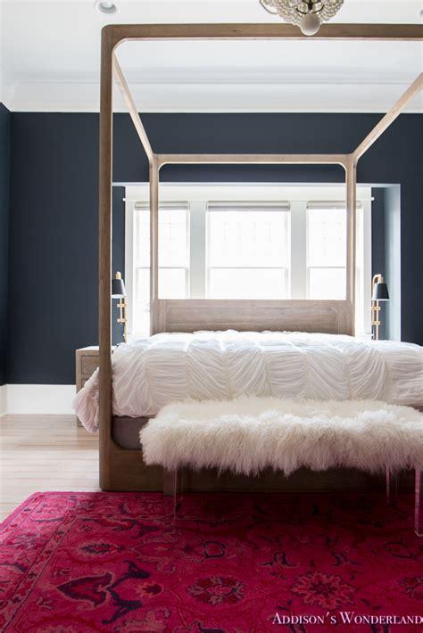 black four poster bed master bedroom black walls white wood bead chandelier