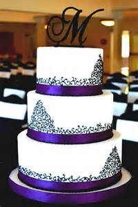 Wedding cake with pearls and piping also elegant purple wedding cake