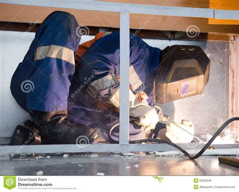 welding in conditions welder working in cred conditions royalty free stock