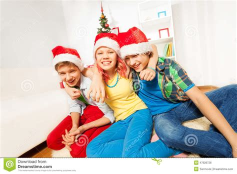teens kids on christmas party in santa hats stock photo