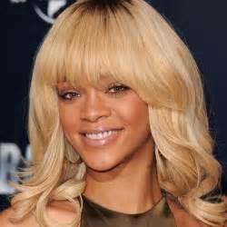 Rihanna with blonde hair and fringe rihanna hairstyles instyle uk