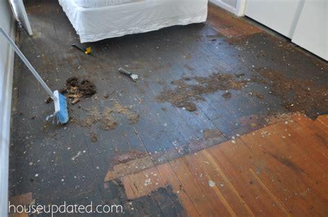 guest bedroom goodbye black floors hello fir floors - How To Remove Carpet Adhesive From Hardwood Floors