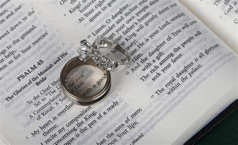 wedding rings   open holy bible stock photo