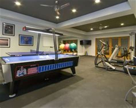200 sq ft mirrored home gym w/ built in TV and rubber
