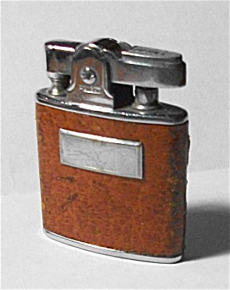 29 Lighters On Dresser by Vintage 1950 Ronson Princess Leather Wrap Lighter