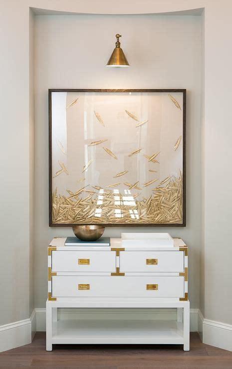 white  gold chest  framed art gray walls