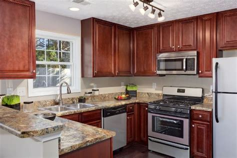 gray paint with cherry cabinets counter material is used to a 5 6 quot backsplash with