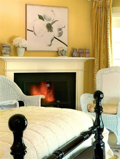 farrow and ball bedroom colors yellow bedroom with white wicker chairs and black lacquer