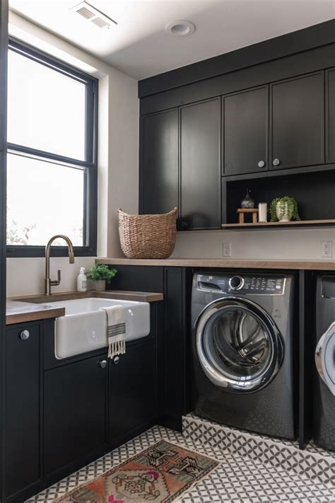 rich black cabinetry   summit creek project laundry