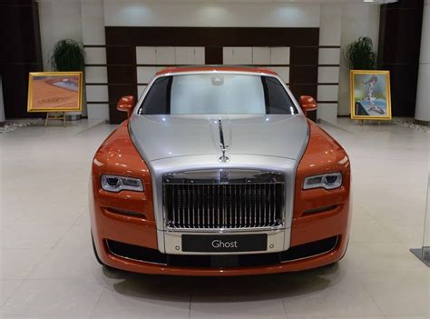 roll royce orange orange metallic rolls royce ghost showcased at bmw abu