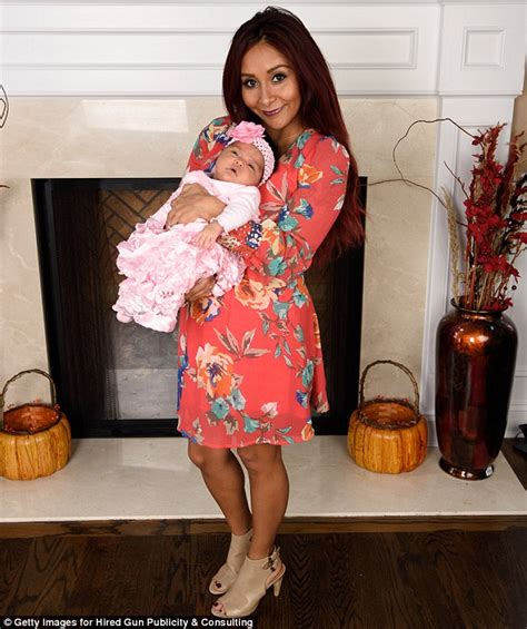 Baby s first photo shoot proud new mom snooki introduces one month
