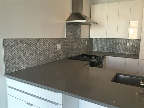 backsplash trim strips marble mosaic herringbone pattern with schluter trim