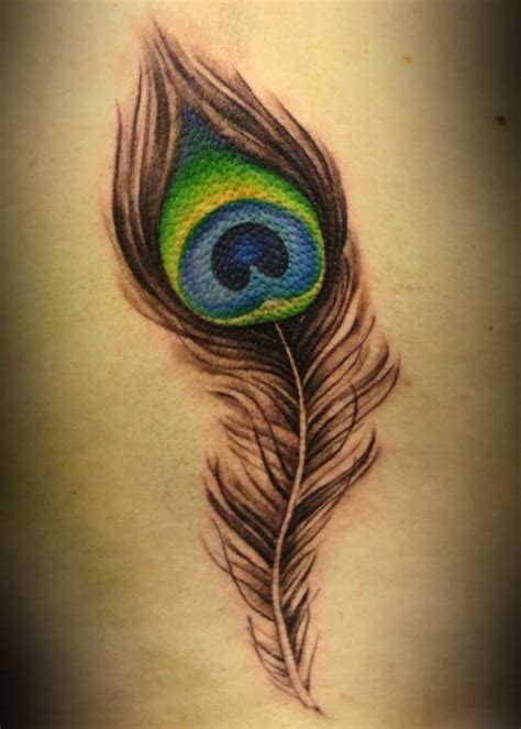 peacock feathers tattoo designs peacock feather meaning fashion belief