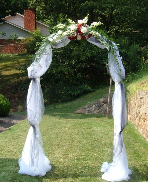 wedding arch covered with tulle and accented with