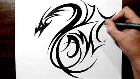 drawing a tribal dragon tattoo design with initials am