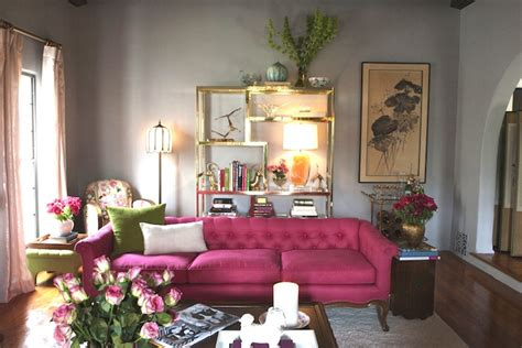 pink living rooms pink tufted sofa eclectic living room emily henderson